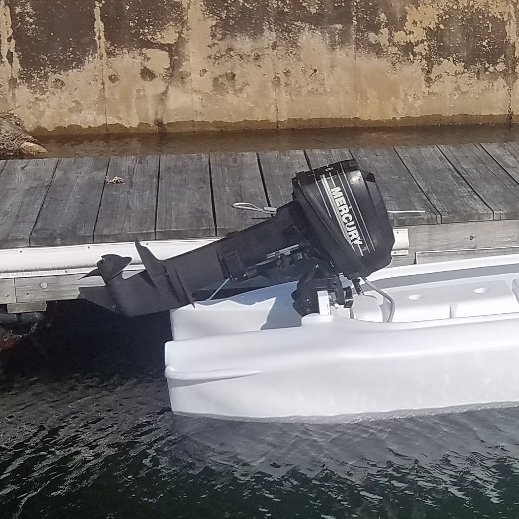 Wavewalk S4 skiff with 8 HP outboard motor
