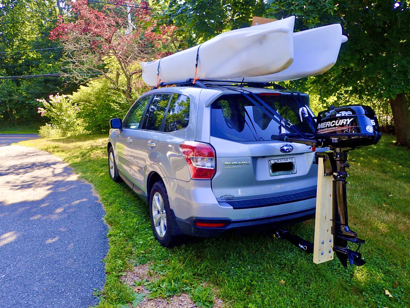 Wavewalk S4 skiff car topped on SUV - Maine
