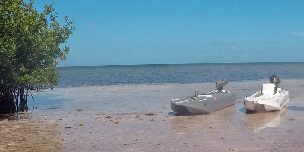 Wavewalk S4 microskiff on ocean beach, Florida