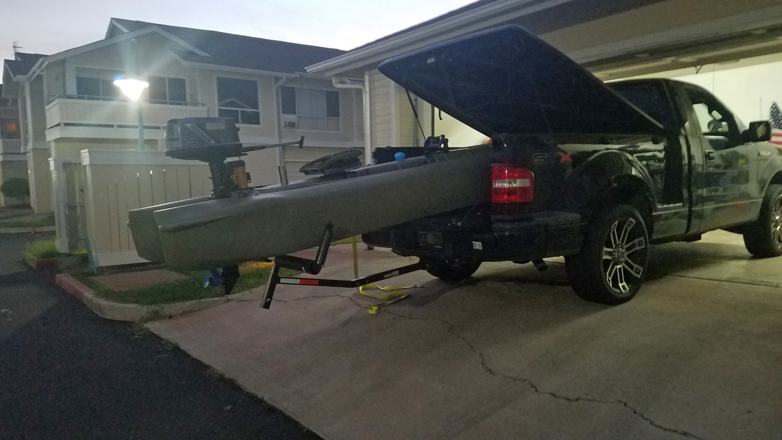S4 offshore skiff transported on pickup truck bed, Hawaii
