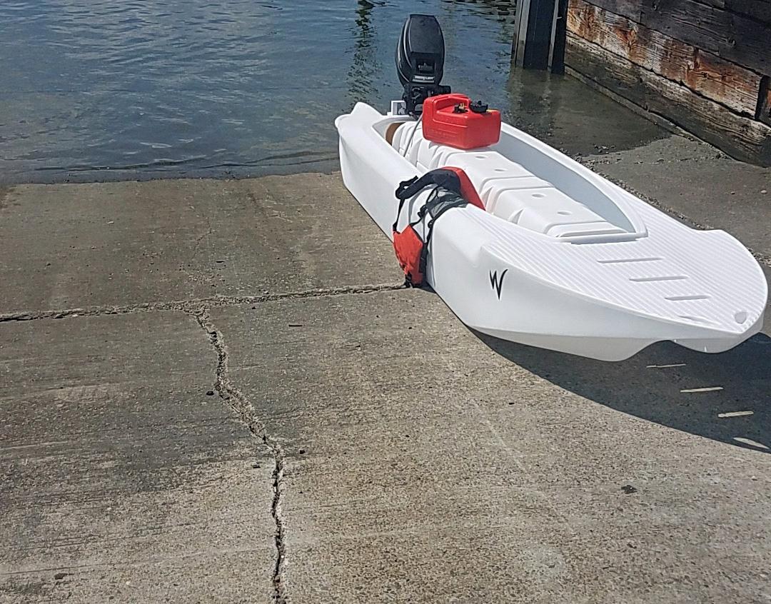 Wavewalk S4 skiff with 8 HP outboard motor, Rhode Island