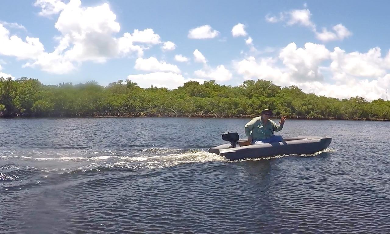 Big and heavy angler comfortably drives a Wavewalk S4 skiff sitting side-saddle