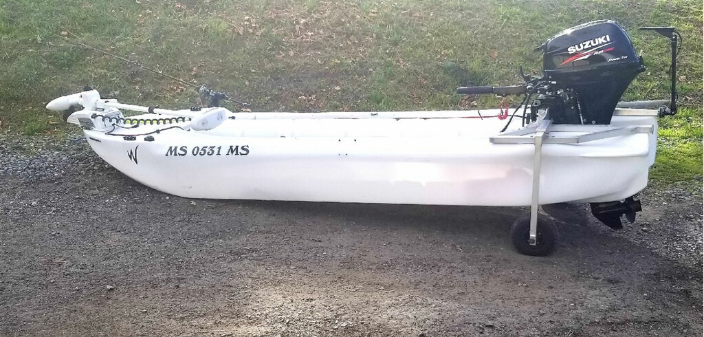 S4 skiff with folding wheels and electric trolling motor at the bow