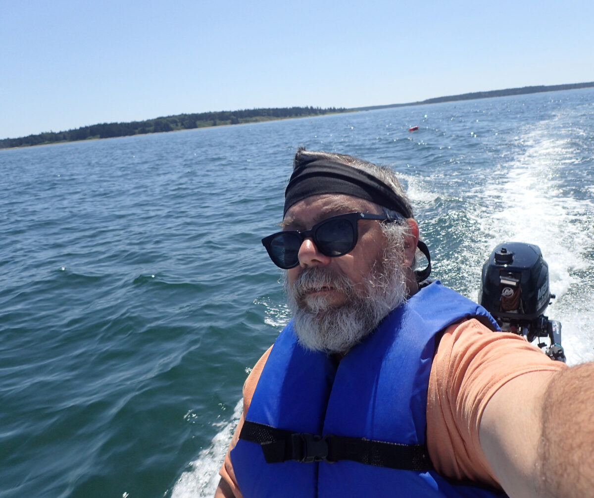 Driving the S4 skiff in the ocean, coastal Maine